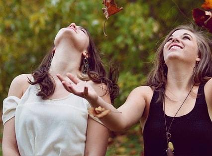Girls Catch Autumn Leaves